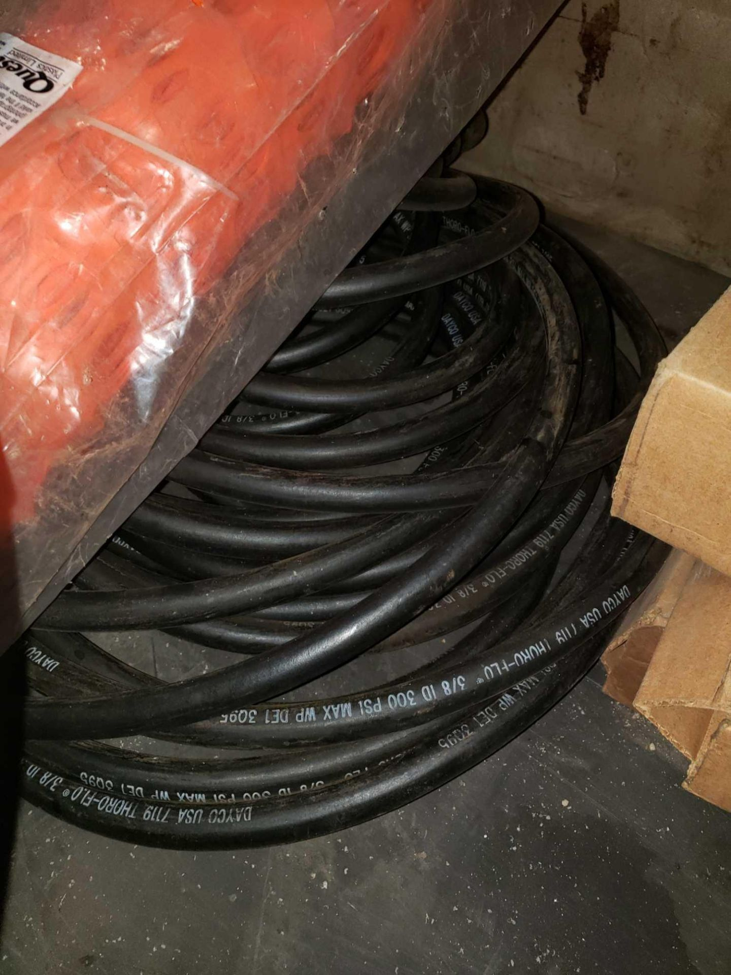 Lot 9 - Assorted lot including snow fence, tape, and assorted hoses
