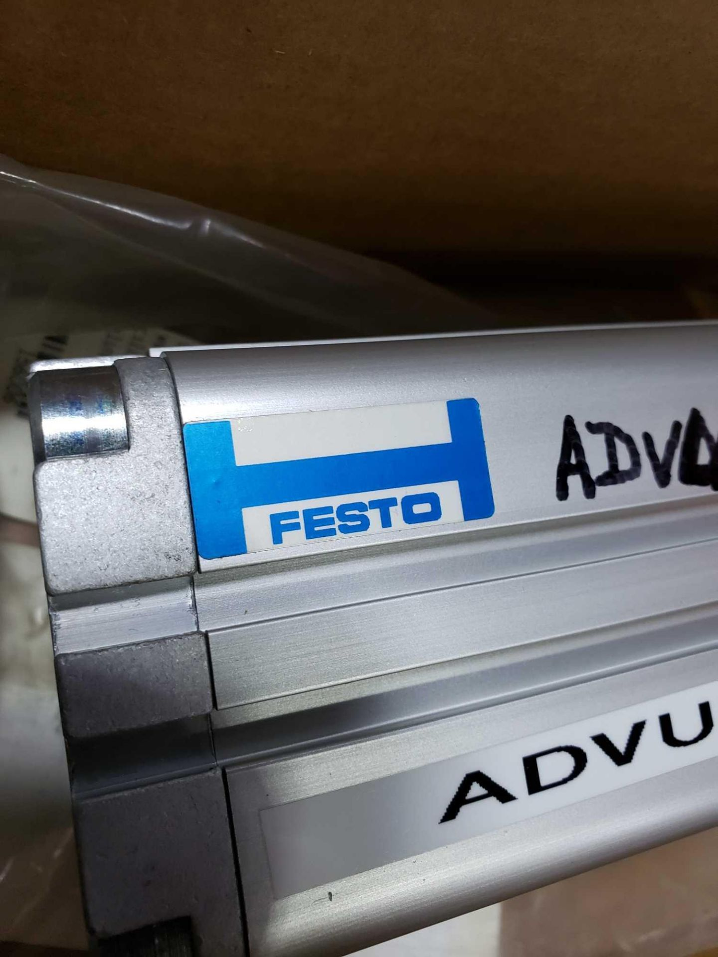 Lot 353 - Festo model ADVU-50-120-PA cylinder. New with minor wear and markings as pictured.