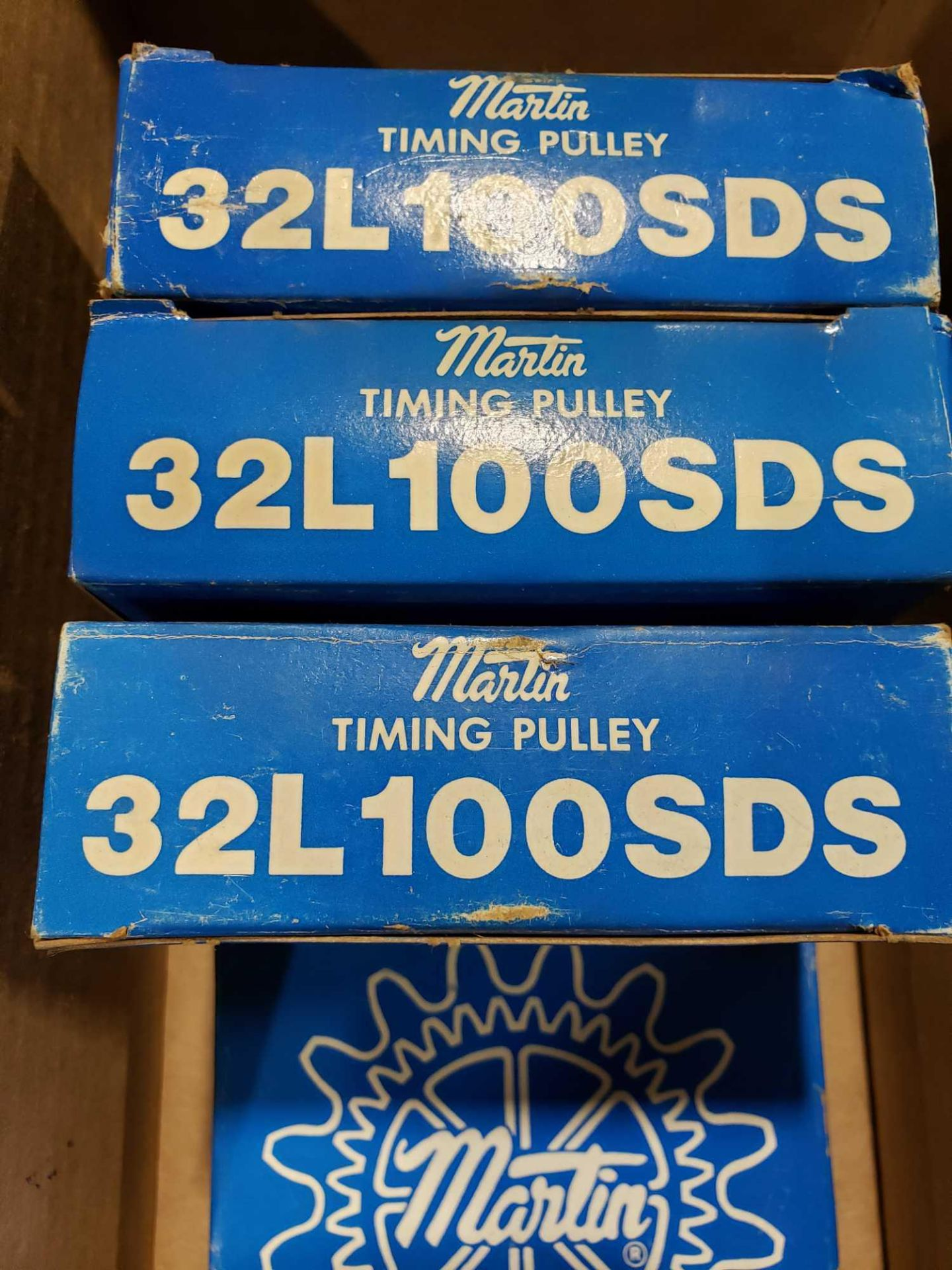 Lot 18 - Qty 4 - Martin timing pulley model 32L100SDS. New in box.