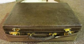 An Edwardian Ladies Vanity Case, With a canvas travelling cover, and silk interior, 15cm high,