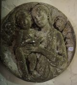 A Stoneware Circular Plaque, Decorated with a moulded religious subject, 52cm diameter