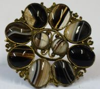 An Agate Brooch, Decorated with two small stones to the centre, flanked by eight larger stones,
