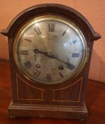 An Edwardian Oak Bracket Clock, With a silvered dial, 32cm high