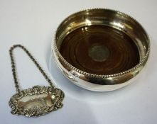 A Silver Wine Coaster, Hallmarks for Birmingham, with a wood interior, 10cm diameter, also with a
