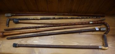 Seven Assorted Walking Sticks, circa early 20th century, to include a military type stick, (7)
