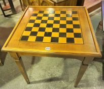 A Modern Games Table, With a detachable chess board top above a backgammon interior, 71 x 69cm