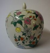"""A Chinese Style """"Famille Verte"""" Oviform Vase, With cover, Decorated with allover panels of flowers"""