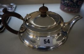 A Silver Tea Pot, Hallmarks for Birmingham, marks rubbed, overall weight 17.635 oz