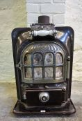 A French Cast Iron and Treacle Glazed Stove, circa 1930s, stamped Deposse, with fitted flue, 70cm