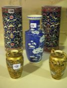 A Pair of Chinese Style Cylindrical Porcelain Vases, Decorated with allover floral panels on a