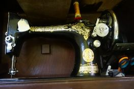 A Vintage Singer Sewing Machine, In original travel case
