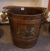 A 19th Century Coopered Fire Bucket, With a leather carry handle, raised on brass mounts, above a
