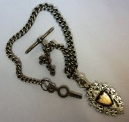 A Victorian Silver Albert Chain, with a silver T bar, also with a silver fob with a gold cartouche