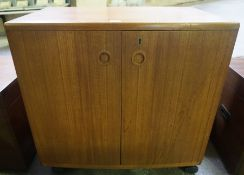 A 1960s Retro Teak Cocktail Cabinet, With two panelled doors enclosing fitted compartments, 67cm