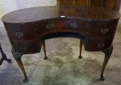 A Queen Anne Style Mahogany Kidney Shaped Desk, With a large drawer flanked by two smaller