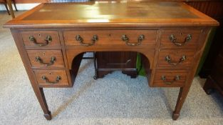 A Mahogany Kneehole Desk, circa early 20th century, with a leather tooled top above a drawer,
