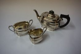 A Silver Three Piece Tea Service, Hallmarks for Sheffield, circa 1930s, comprising of tea pot, sugar