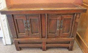 A Chinese Style Hardwood Cupboard, With two pairs of two doors enclosing a shelved interior, 76cm