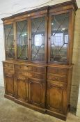 A Reproduction Mahogany Breakfront Bookcase, With four glazed astragal doors enclosing a shelved