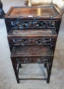 A Chinese Rosewood Nest of Three Tables, circa early 20th century, with fruit and vine decoration,