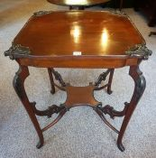 An Edwardian Mahogany Window Table, With a square shaped top above undertier, 74cm high, 62cm wide
