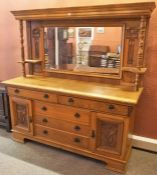 Attributed to Liberty, An Arts and Crafts Oak Mirrorback Sideboard, The mirrored section raised on