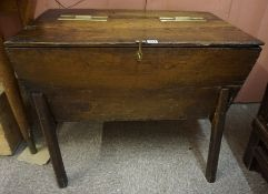 A 18th Century Oak Dough Bin, With a hinged top with later brass brackets, 84cm high, 82cm wide,