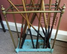A Brass Stick Stand, circa early 20th century, with open divisions above a painted base, 62cm