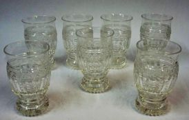 Seven Matching Crystal Tumblers, circa early 20th century, of shaped form with star cut bases,