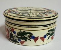 A Scottish Pottery Wemyss Style Jar with Cover, Decorated with a Masonic emblem within painted
