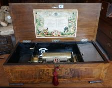 A Large Continental Walnut Cased Music Box, circa early 20th century, enclosing crank lever,