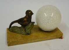 An Art Deco Desk Light, In the form of a bronzed bird with a mottled glass shade, raised on a marble