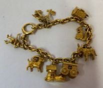 A 18ct and 9ct Gold Charm Bracelet, The chain stamped 18 to link, with eleven assorted gold