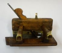 A Wood Plough Plane, circa early 20th century, stamped Thompson, with brass mounts and screw, 22cm