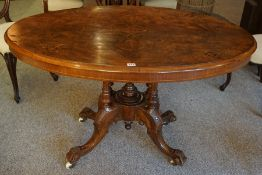 A Victorian Figured Walnut Inlaid Loo Table, The oval snap action top decorated with satinwood