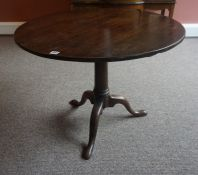 A George III Mahogany Supper Table, With a circular snap action top, raised on a cylindrical