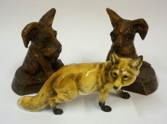 A German Porcelain Figure of a Fox, signed to underside, 23cm long, also with a pair of carved