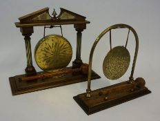 A Model Oak and Brass Dinner Gong, With beater, 30cm high, 76cm wide, also with a similar dinner