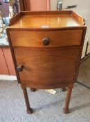 A Walnut Pot Cupboard, In the style of Whytock and Reid of Edinburgh, With a gallery top above