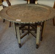 A Persian White Metal Occasional Table, circa early 20th century, raised on mosaic themed folding