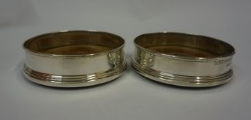 A Mixed Lot of Assorted Silver, To include two silver mounted wine coasters, six napkin rings, two