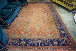A Large Persian Keshan Style Carpet, Decorated with panels of flowerheads on a red ground, areas