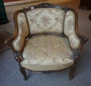 A French Walnut Armchair, circa early 20th century, Upholstered in floral fabric, 78cm high, (has