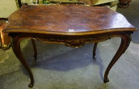 A French Walnut Side Table, 20th century, Having a kingwood panel to the top and serpentine front,