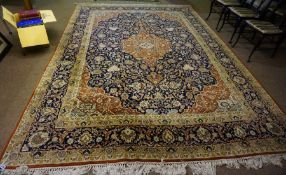 A Large Persian Carpet, Decorated with a large floral medallion, with further floral motifs on a