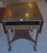 A Mahogany Pembroke Table by Edwards & Roberts, circa early 20th century, stamped to interior of