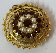A Fine 18ct Gold Ruby and Seed Pearl Brooch, Of balloon shape, Decorated with a central ruby