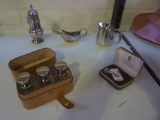 A Small Mixed Lot of Silver Plated Wares, To include a set of three glass cologne bottles in