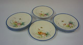 A Porcelain Eight Piece Fruit Service, circa early 20th century, Decorated with a floral panel and