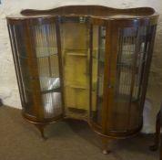 A Vintage Walnut China Cabinet, Enclosing glass shelves, 119cm high, 118cm wide, 37cm deep